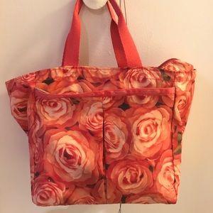 Sportsac small handbag. Pink and red flower trim.